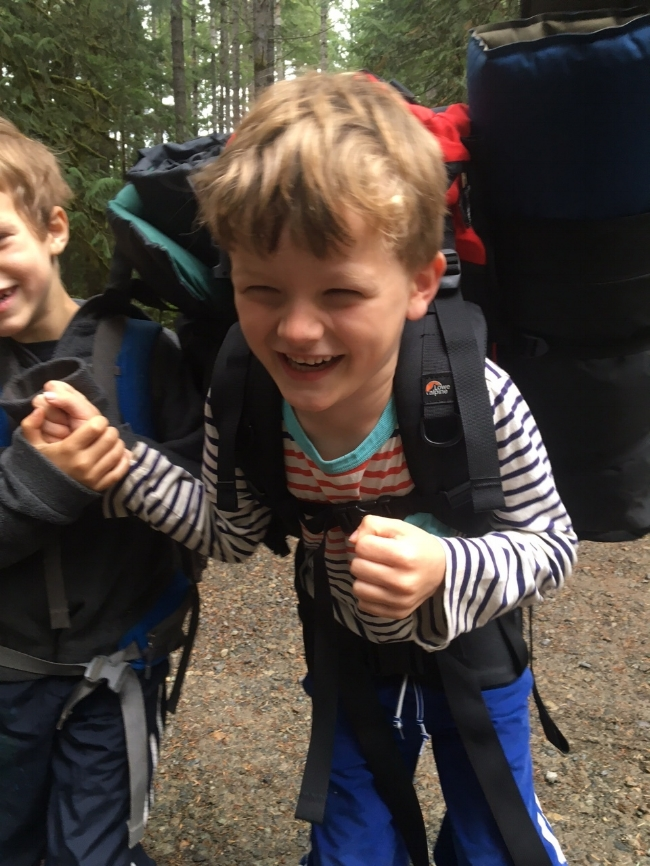 My son, having a chuckle with his buddy before chucking the backpack at the trail head (guess who then put it on?).