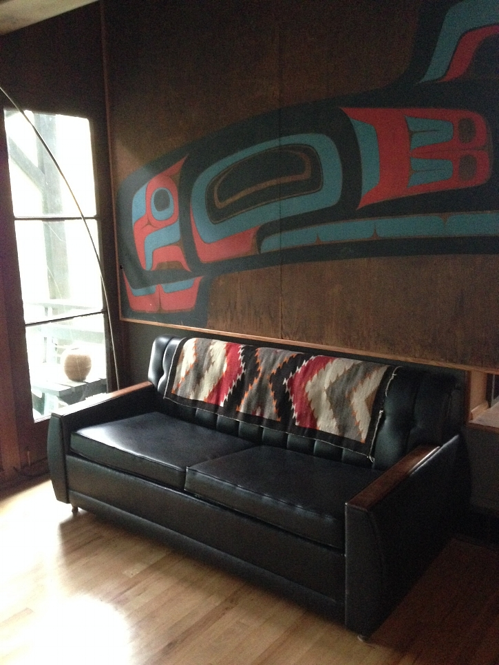 There you have it, the afore-mentioned leather furniture, northwest coast art, and textiles! The huge wood panels are by Bill Holm, who created it for the Seattle World's Fair. The two panels were originally part of an eight piece set which made up a giant display bentwood box. We visited Bill to ask him what the image is of, but he said it's more of a collection of iconic northwest coast graphic designs than a particular animal or story.