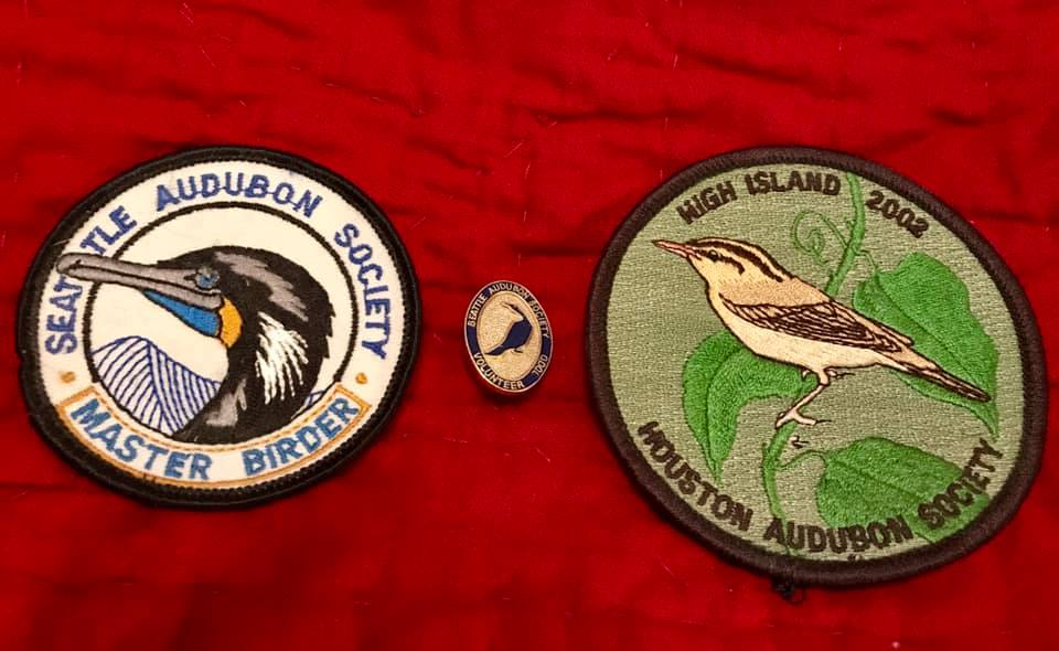 Them's bragging rights! Izzy Arévalo Wong's Seattle Audubon Master Birder Patch (2001), Seattle Audubon pin for 1000 hours of volunteer time, and a High Island patch, where she birded several times.