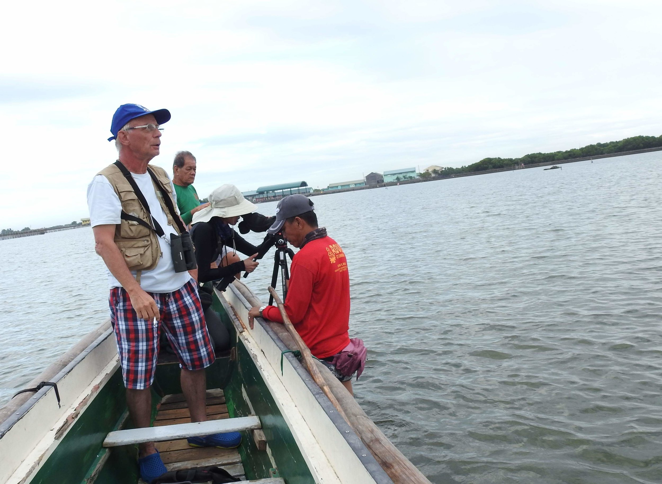 In Bulucan, the Philippines, trying to see birds in water too shallow to proceed by boat. Photo by Angelo Ganotice.