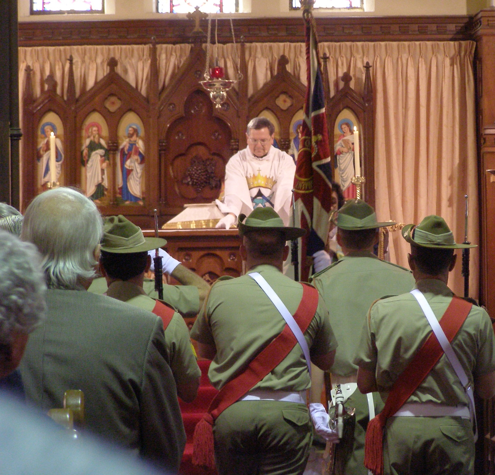 Serving Battalion colours laid on the altar during the annual Milne Bay Service
