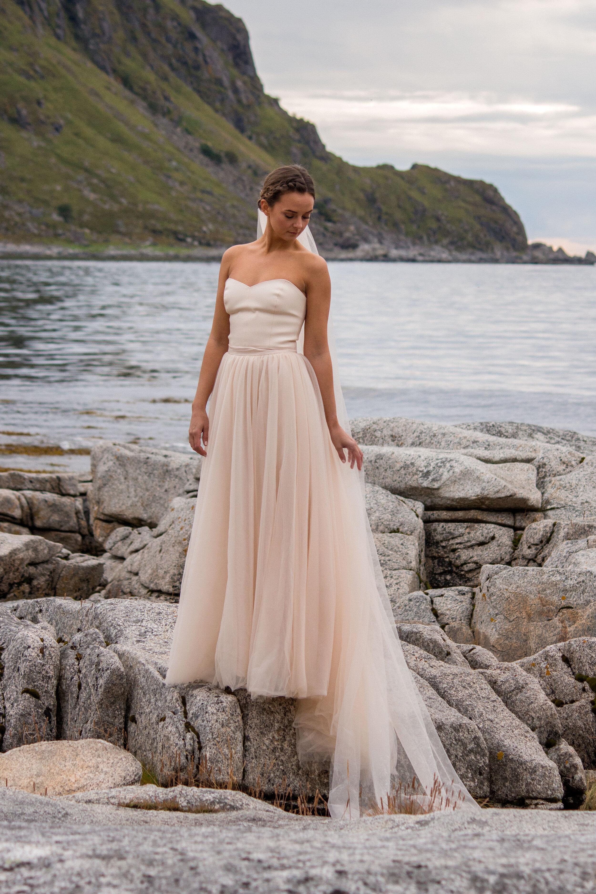 The beige tulle skirt however, is from our own brand  Ellen Marie Bridal by Sisters in Law . We made a long veil in the same color, and a shoulderless top in fake leather.
