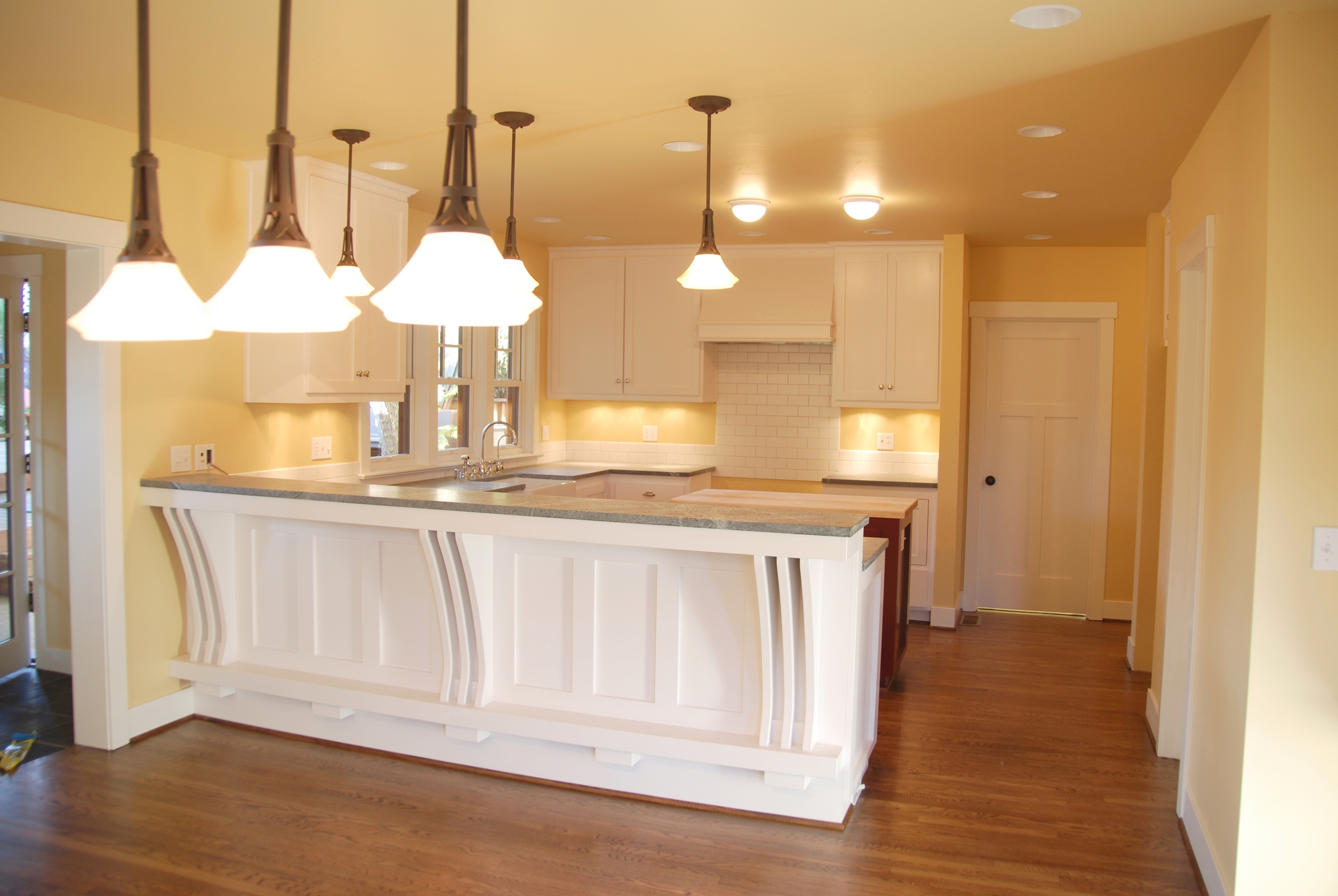 AFTER:   New Kitchen is spacious and flows into the new Dining space beautifully