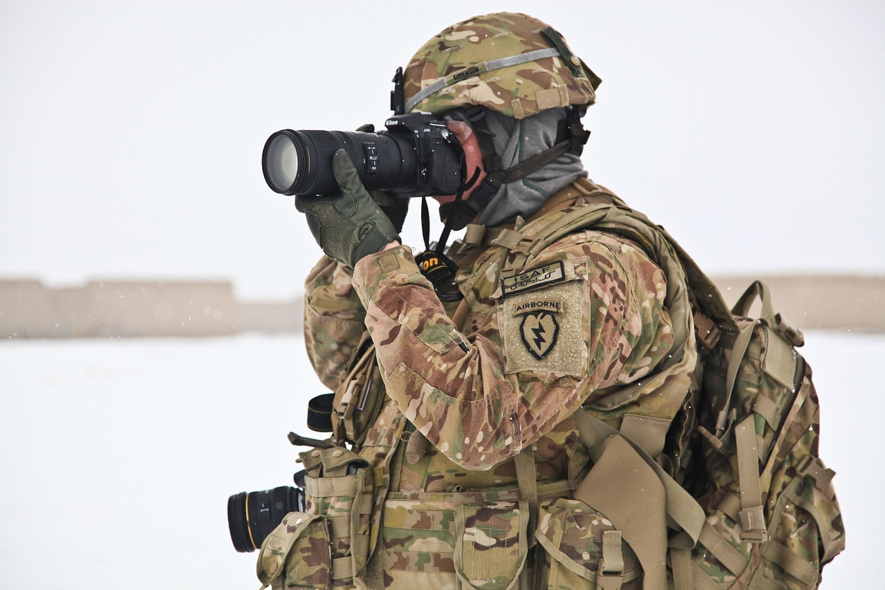 AS A CONDITION OF YOUR EMPLOYMENT YOU MAY BE REQUIRED TO CARRY 40-70 POUNDS OF GEAR INCLUDING A KEVLAR HELMET, KEVLAR BODY ARMOR AND rucksack.cumulative trauma, strain, and traumatic injuries resulting from carrying heavy gear for prolonged periods of time over uneven terrain may give rise to a compensable claim under the defense base act.