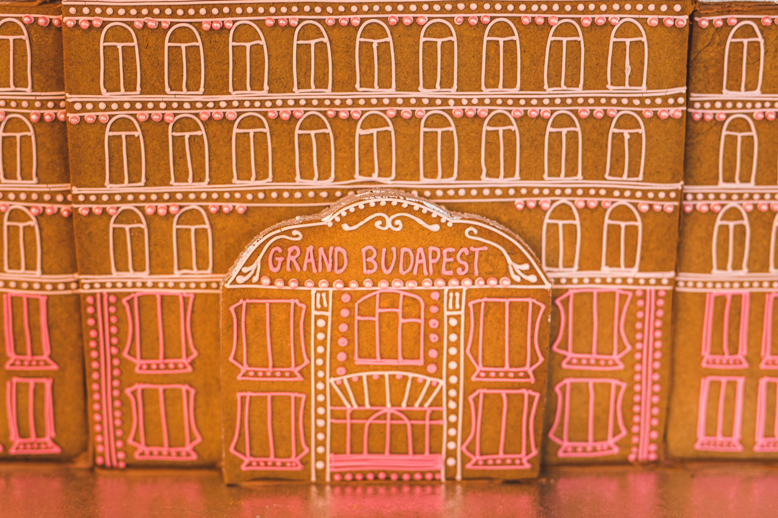 Hand-piped icing windows on The Gingerbread Grand Budapest Hotel. Photo by  Kirsty Mackenzie .