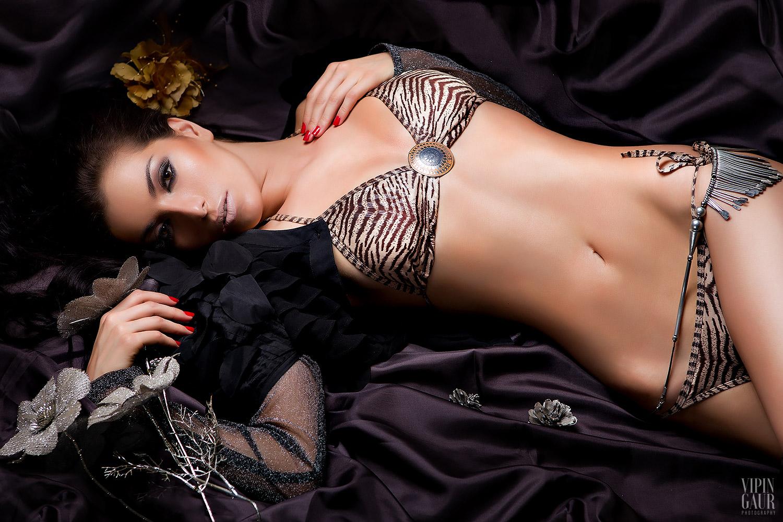 Lying sensually on the satin sheet
