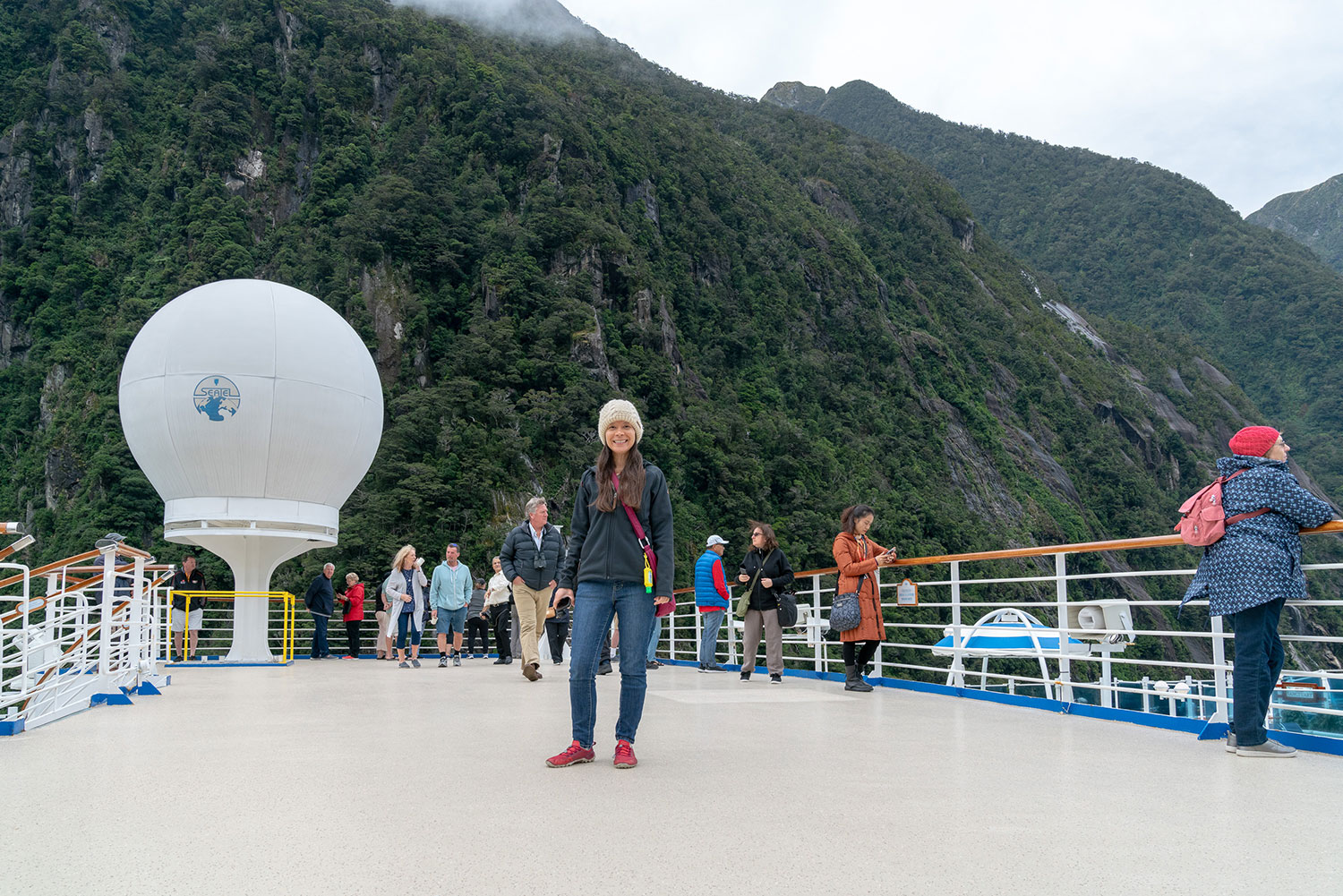 Thaneeya McArdle at Milford Sound, Fiordland National Park in New Zealand