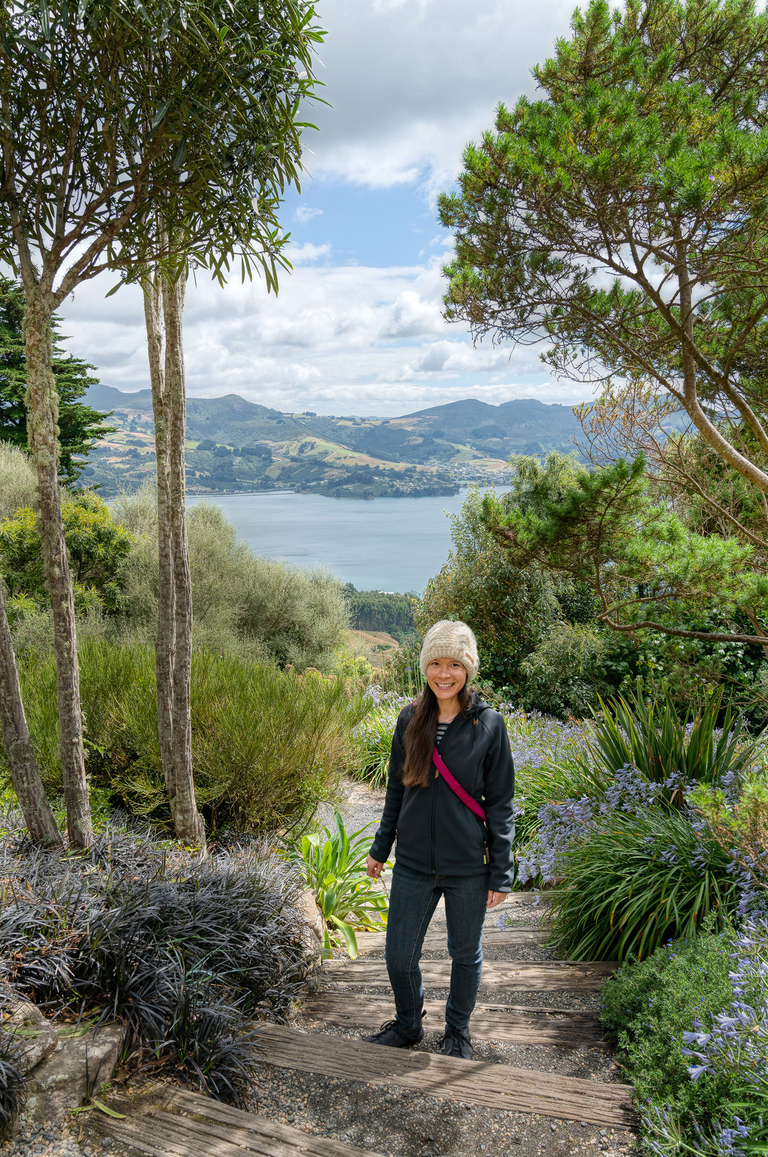 Thaneeya McArdle on the grounds of Larnarch Castle in New Zealand, overlooking Otago Harbour