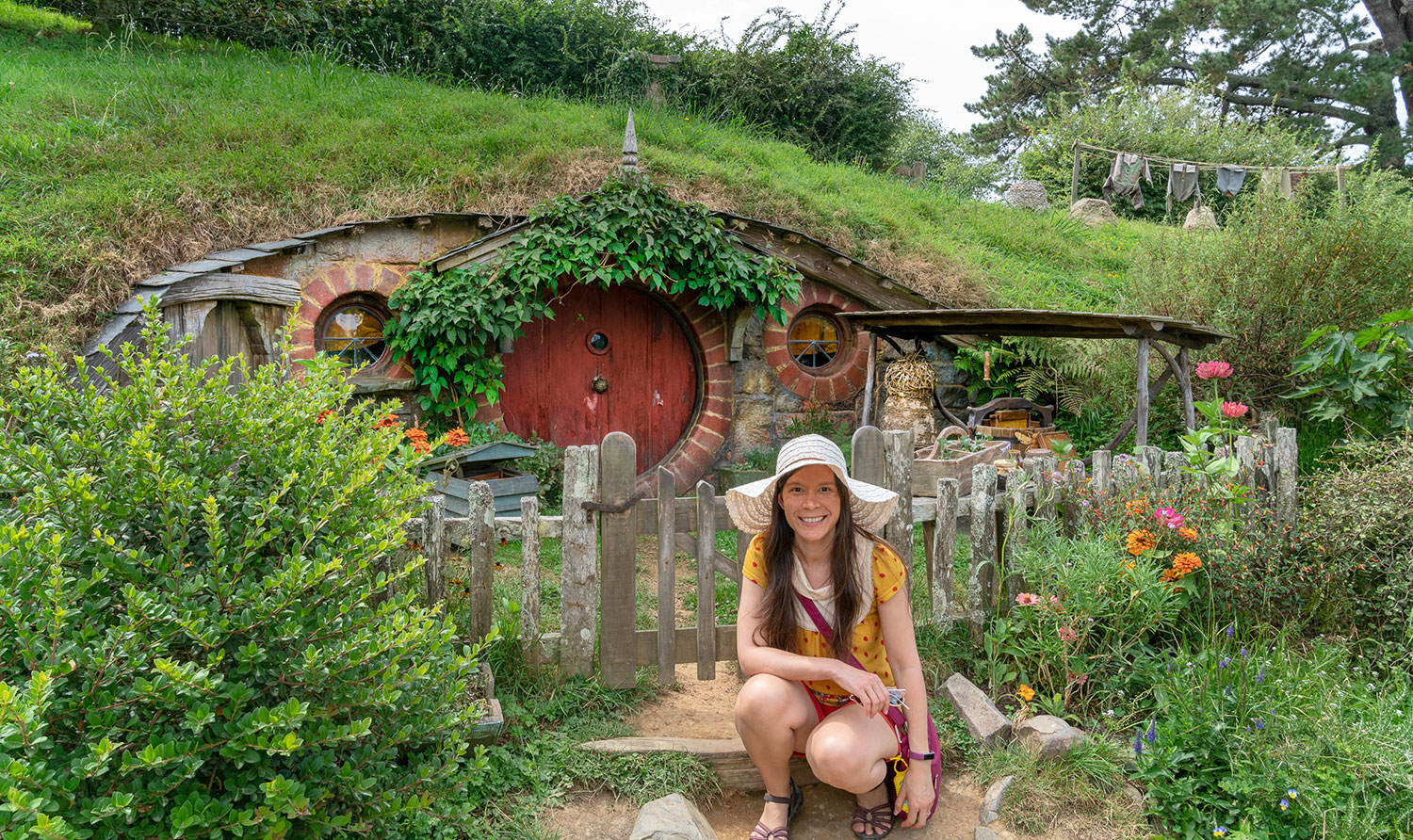 Thaneeya McArdle in front of a Hobbit hole in Hobbiton