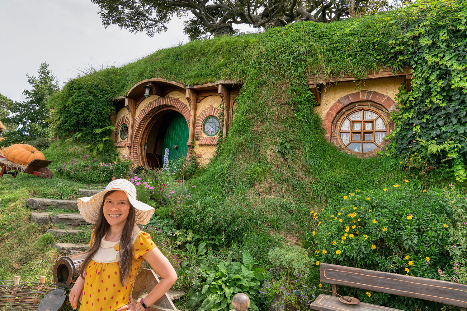Thaneeya McArdle in front of a Hobbit house in Hobbiton