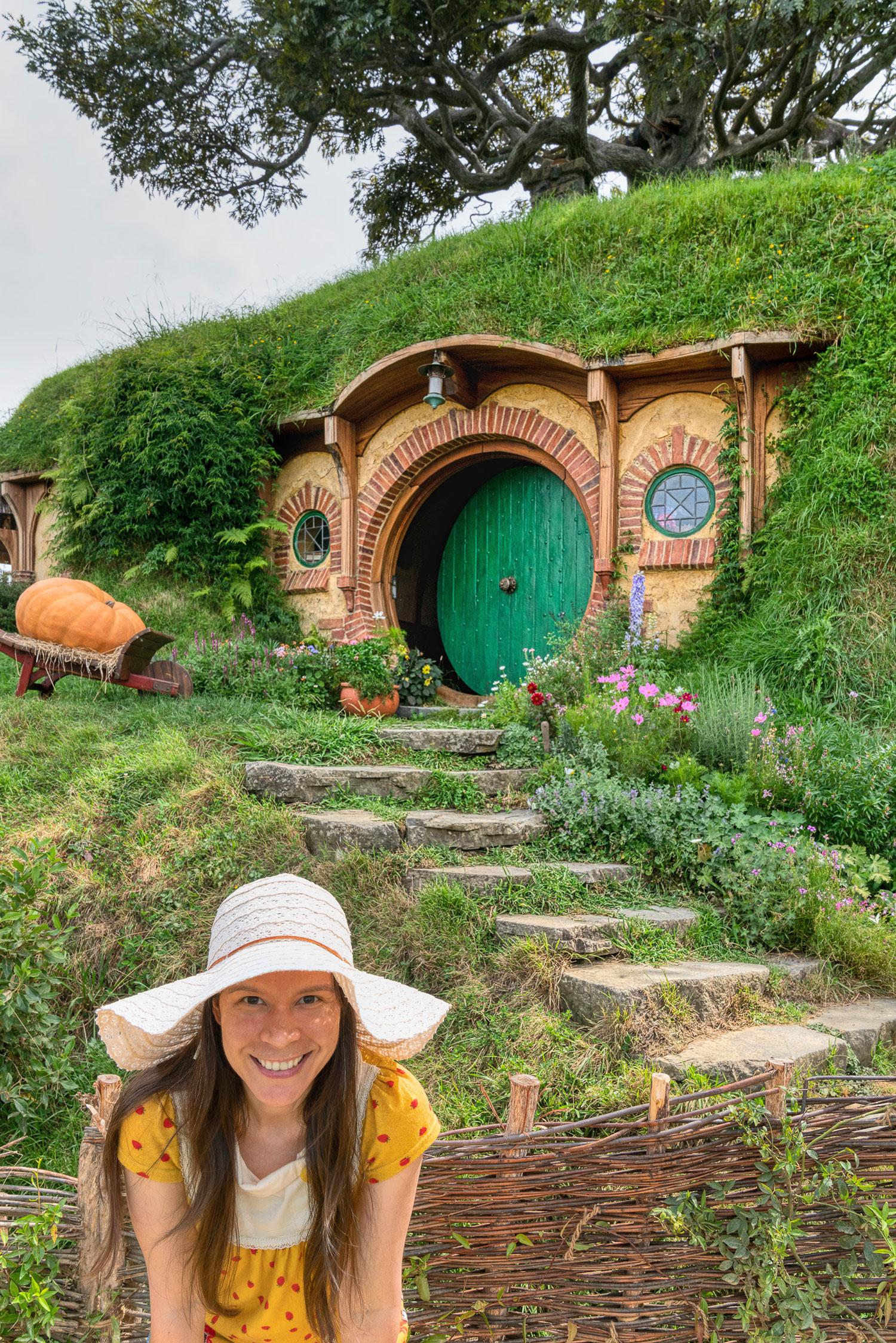 Thaneeya McArdle in front of a Hobbit home in Hobbiton, Matamata, New Zealand