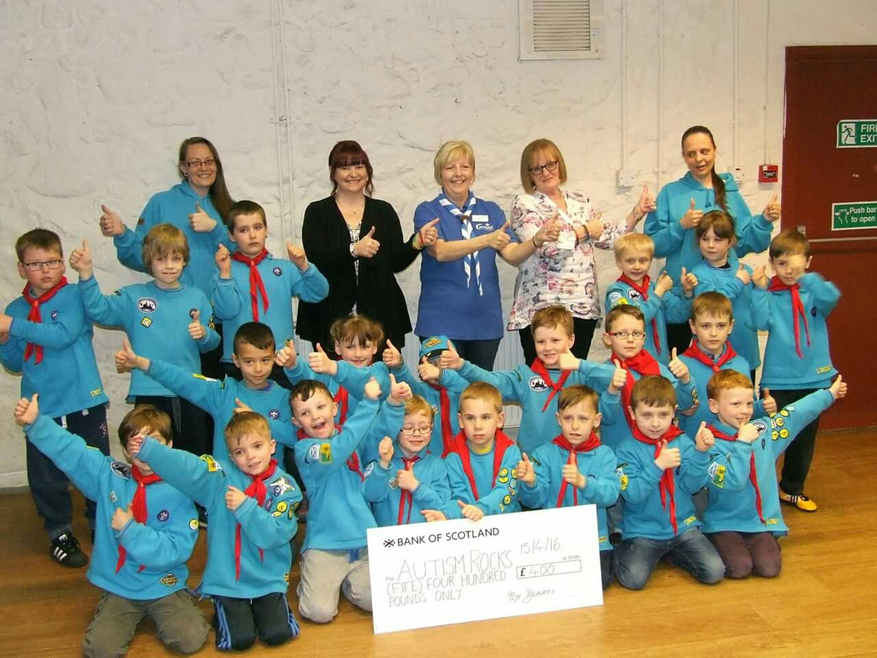 Receiving our cheque from the beavers .