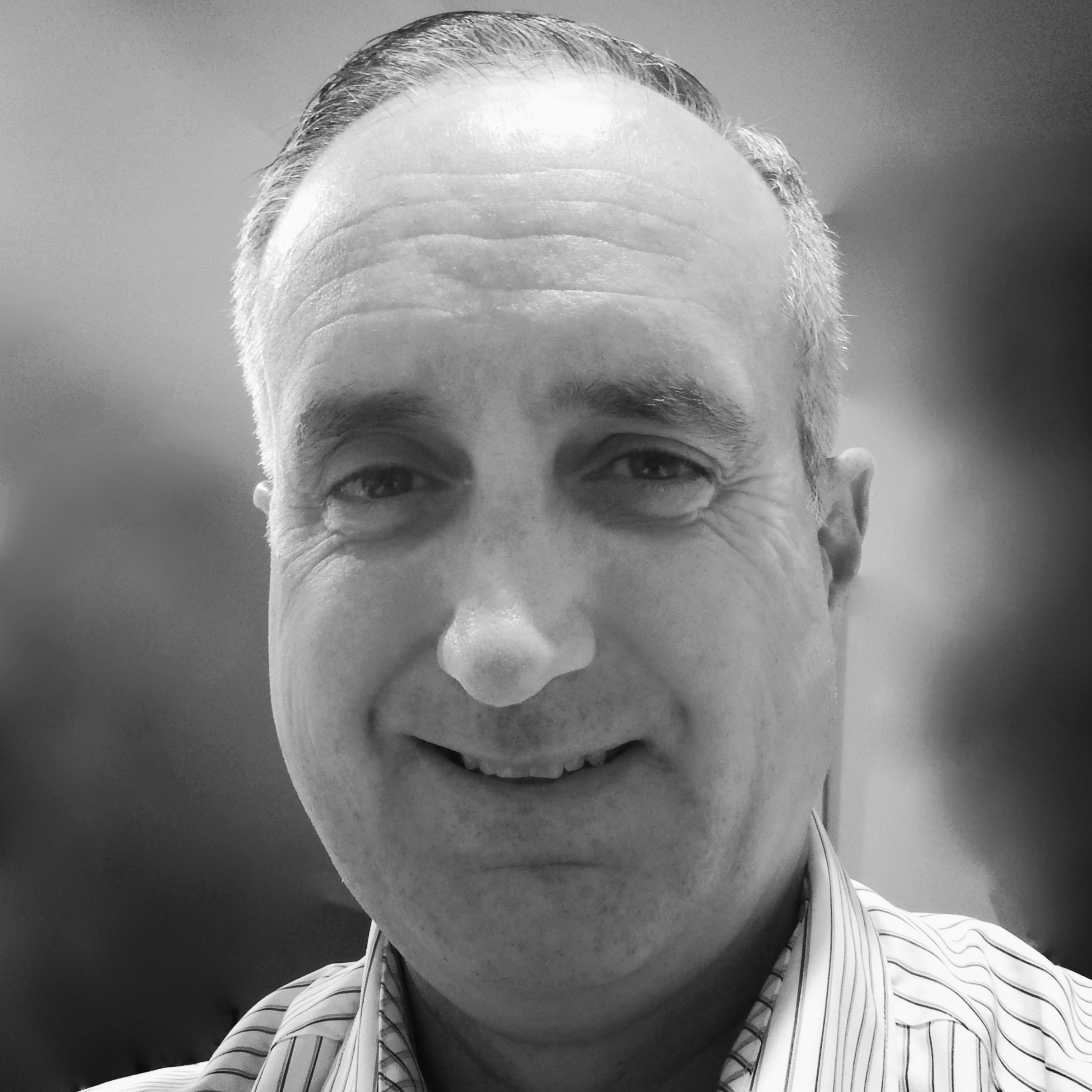 JOHN TOMICK Board Member