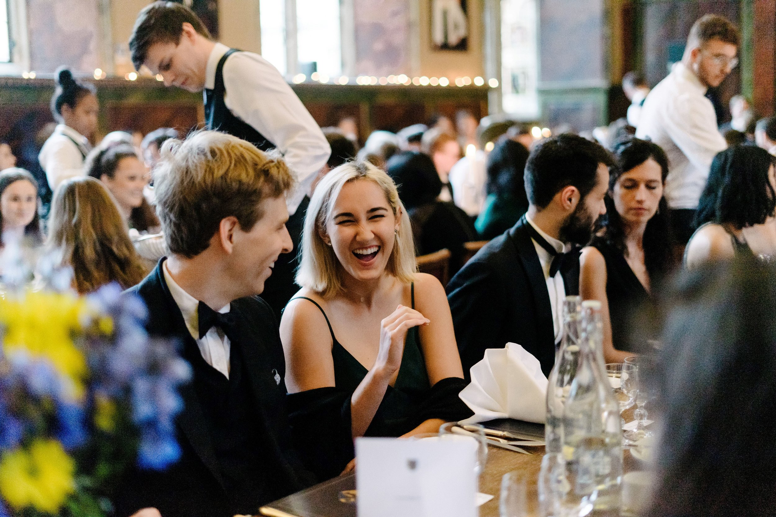 Members of the MCR share a light moment during the gala dinner   Photographer: Izzy Romilly