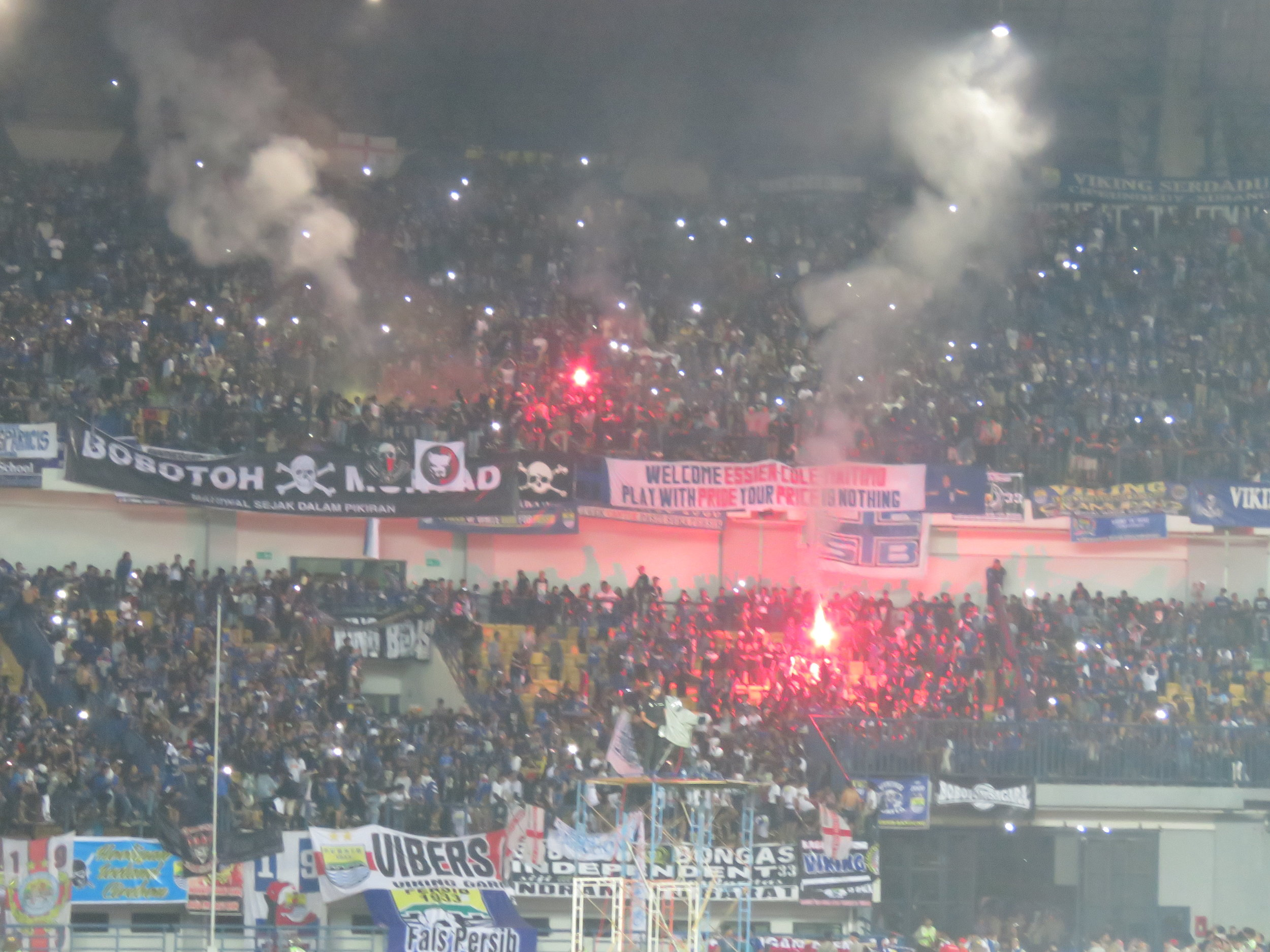 Post-match flares. Note the banner about Essien and Cole