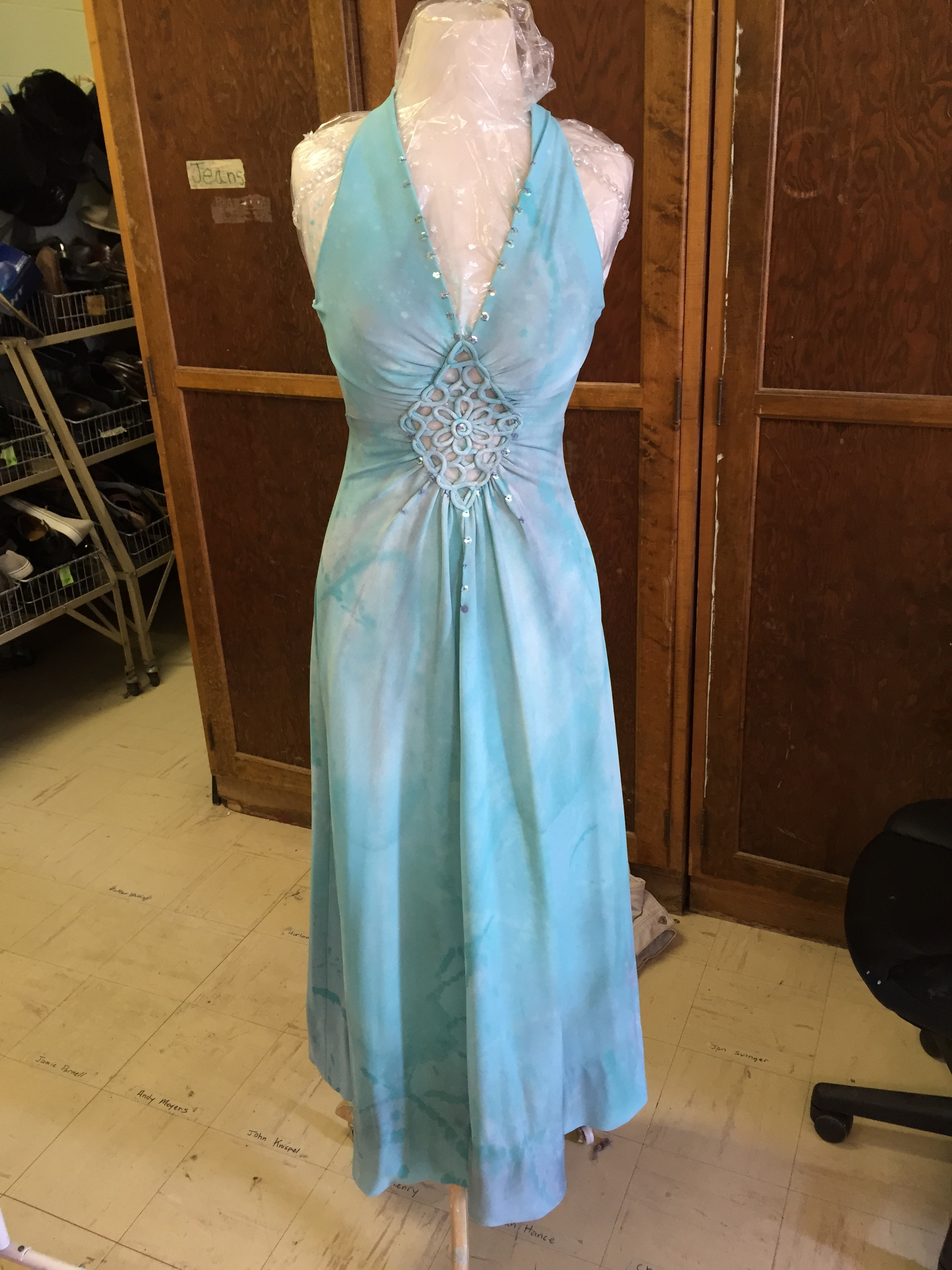 This dress was found in costume stock distressed with mud, paint, and dirt. We treated it with washes of paint to hide the distressing and give the dress a marble appearance.