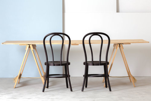 WOODEN TRESTLE TABLE & BLACK BENTWOOD CHAIRS.