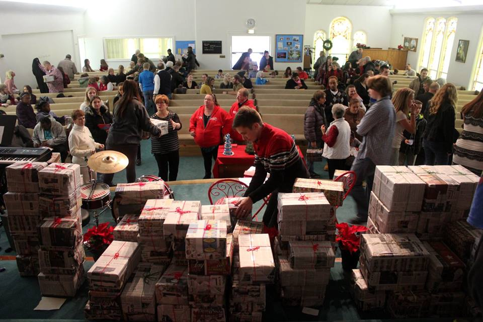 This was a picture of our community Christmas service last weekend. We gave away 115 Christmas presents to families from the community. Wow!