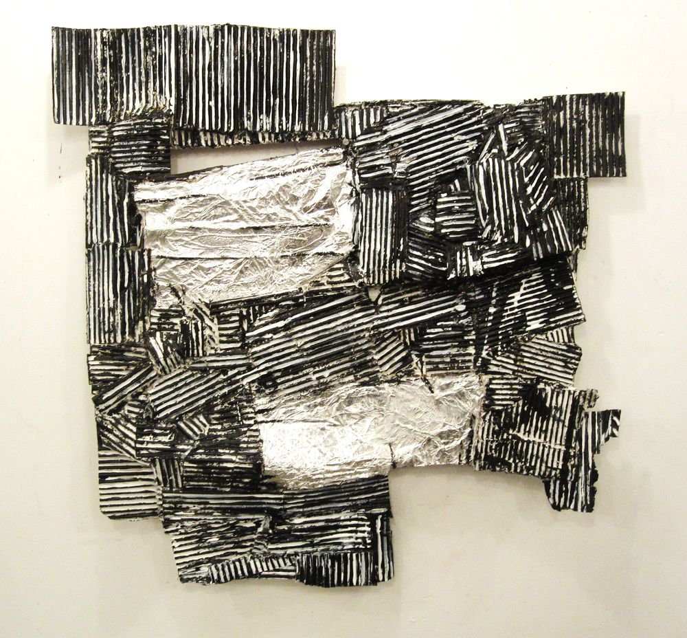 "Black & White Construction, 2011, acrylic, cardboard, aluminum foil and wood, approx 28"" x 34"""