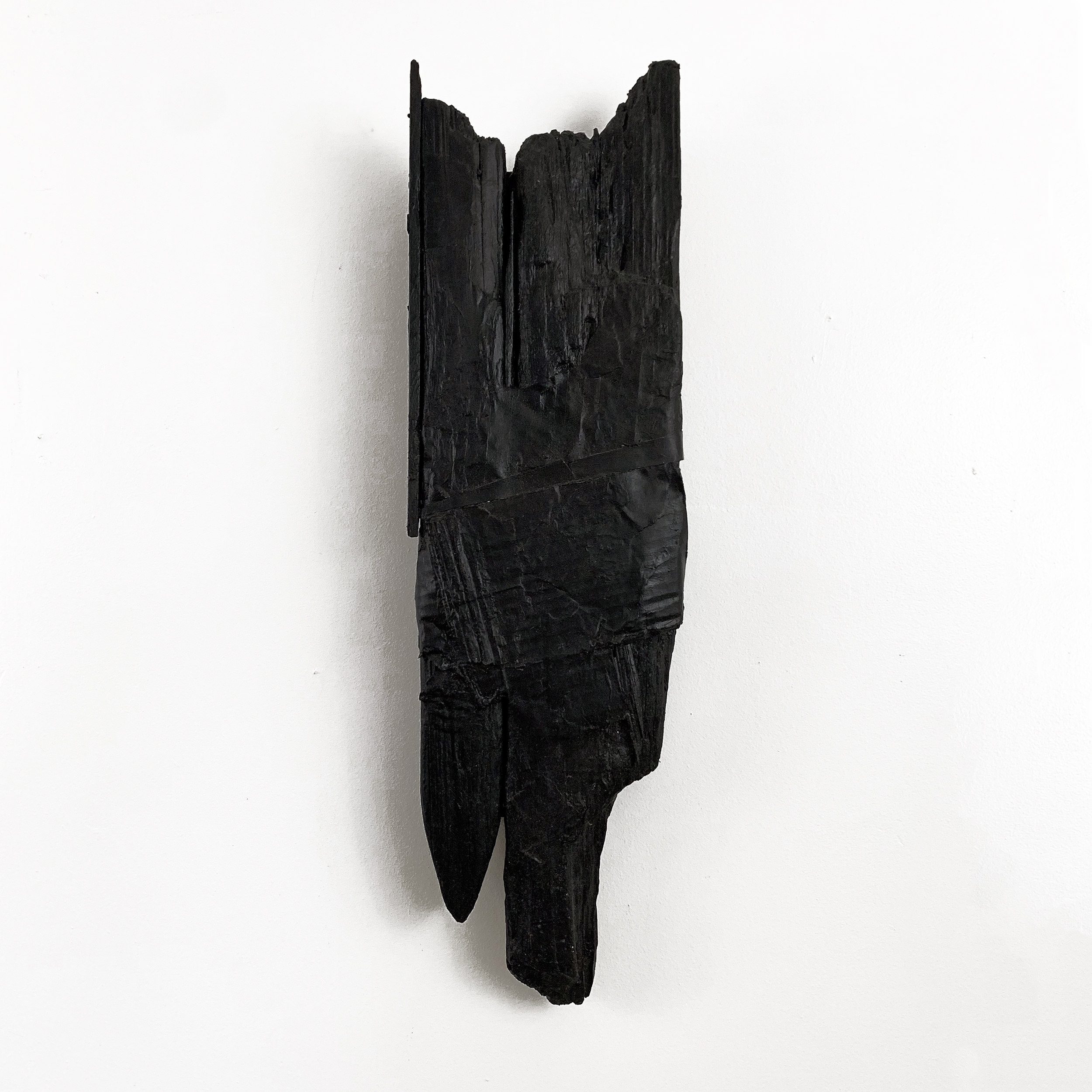 "Totem, 2013, acrylic, cardboard and wood, 28"" x 8"" x 3.25"""