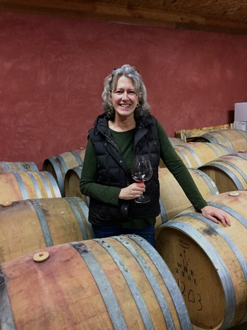 Laura Batistich, Emilio's wife and co-producer of their wines, in their straw-bale wine cellar located within 5 miles of Green Valley Vineyard.