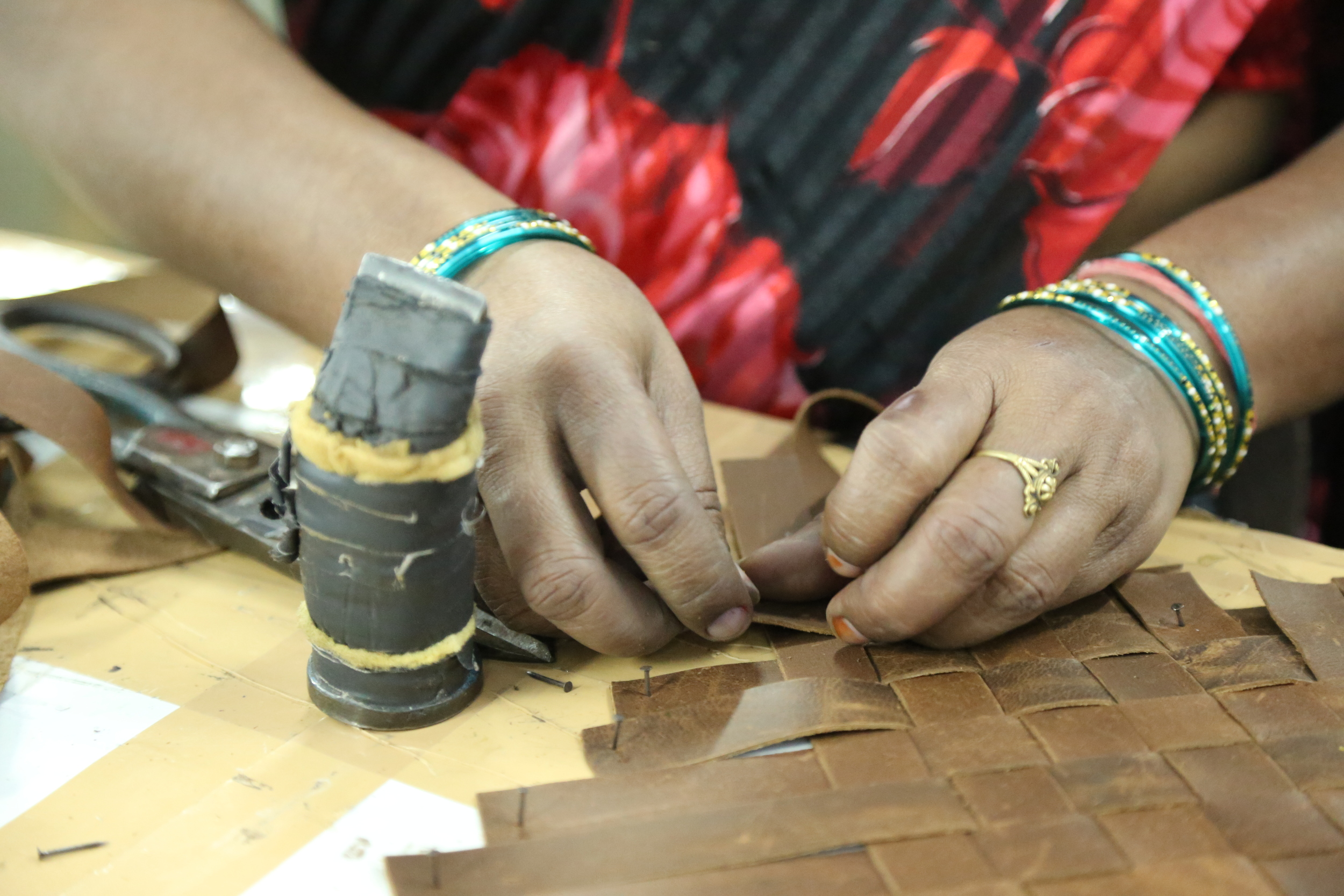 In an upcycling initiative with  TRMTAB , our craftswomen are weaving strips of waste leather.