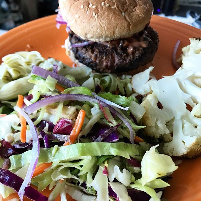 🍔FOR THE RECORD, I sent this pic to my mom (hi @tinadkasab) and she thought this was from a restaurant 🙌🏻🤪 goal accomplished! Haha but really.... we had @beyondmeat for the first time last weekend and we really liked it! The fat content is a bit high at 20 grams but net carbs are 2 for 1 patty.  I served with a side of cauliflower & Mediterranean salad from TJs + made a homemade Russian dressing on a whole wheat bun with red onion. The tips I got when I asked you guys about them:⁣ ⁣ * Don't overcook! Keep pink in the middle. ⁣ ⁣ * Season with salt and pepper to add flavor ⁣ ⁣ * Cook as though it was a normal burger!⁣ ⁣ What are your thoughts on @beyondmeat? There are conflicting opinions. Would love to hear! .  #sweatandheels #beyondmeat #plantbasedalternatives