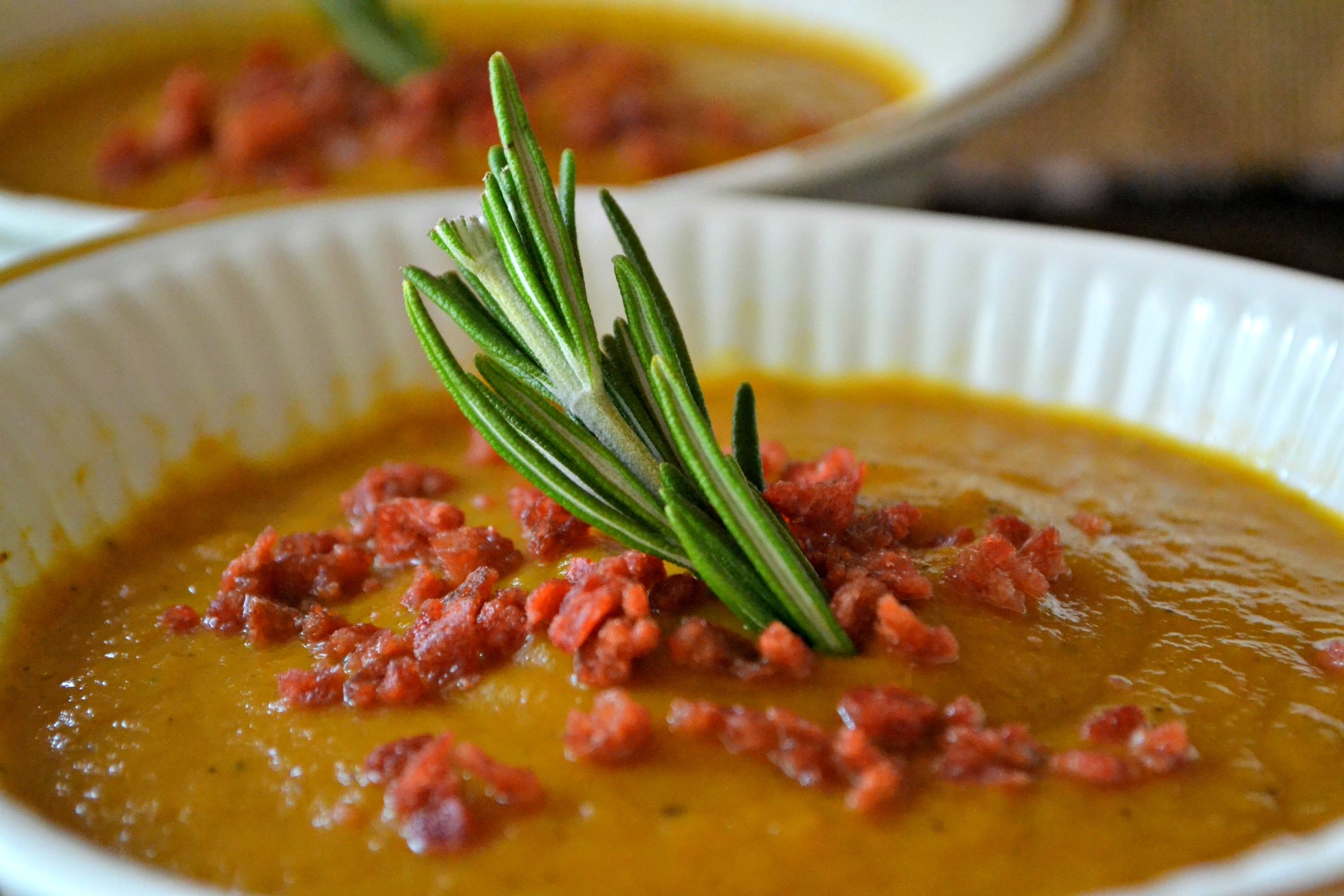 Pumpkin and Carrot Soup with Crispy Bacon and Rosemary  -   Pumpkin soup. Perhaps the quintessential fall/winter food. That and casseroles.   But soup warms you from the inside out, like only tea does. This soup was so delicious and easy to make! Plus you'll have leftovers for at least two more meals with this recipe.