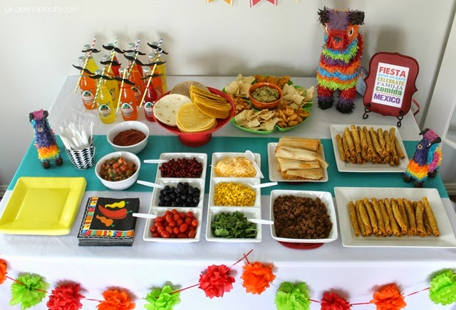 If you don't have a make-your-own taco bar at your  party,  then it's not a party! Simply lay out your taco shells and toppings and let your guests go wild!