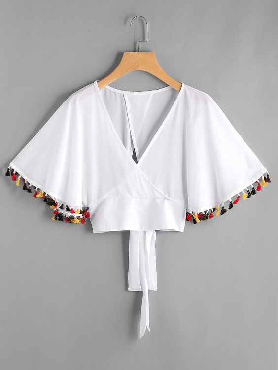 Can't resist pom poms - Is it cheesy that I want to use my white fabric to make this white kimono style top? No? Okay!BTW, I'm probably obsessed with the idea of pom poms for the summer.