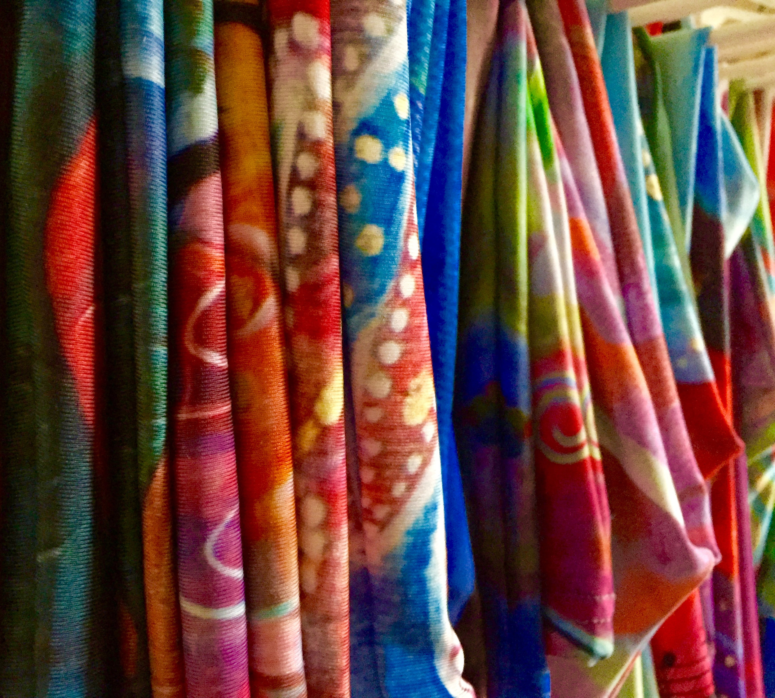 The brilliant colors of leggings, capris, skirts and yoga capris printed with Clair's paintings.
