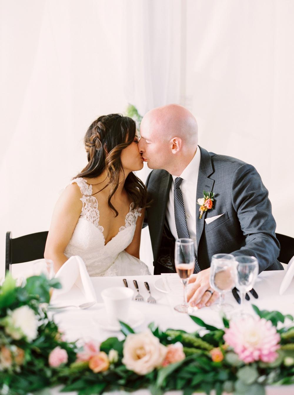 Calgary Wedding Photographer | Meadow Muse Pavilion Wedding | Canmore Photographers | Fish Creek Park Tent Wedding | Bride and groom kiss