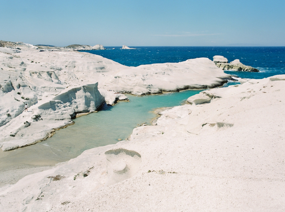 Greece Travel photography fine art film prints of greece | Milos Sarakiniko | moon like rock and blue water | stunning greek landscapes