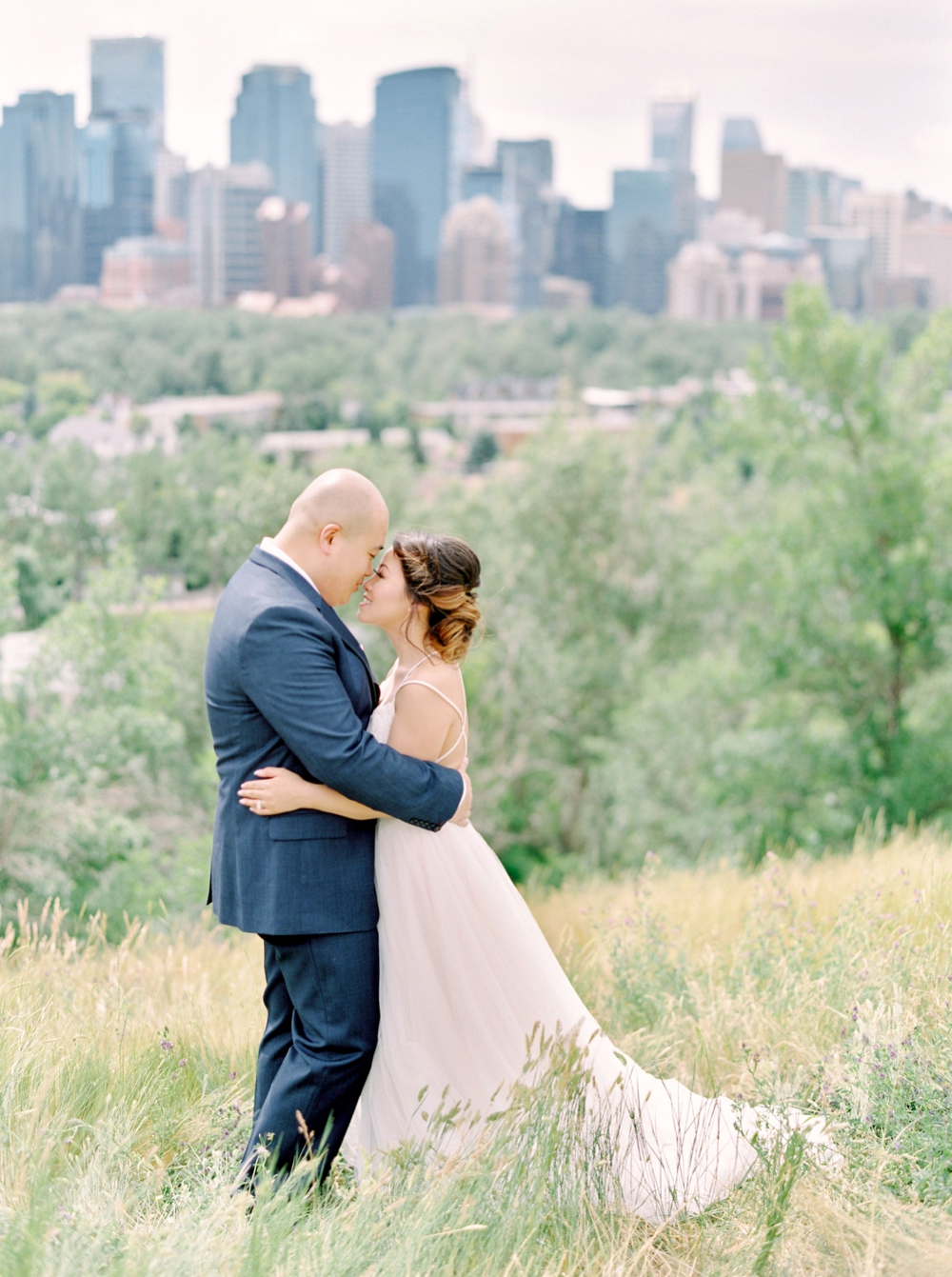 Bride and groom portraits downtown calgary | BHLDN wedding dress | Justine milton fine art wedding photographers | calgary wedding at the lake house