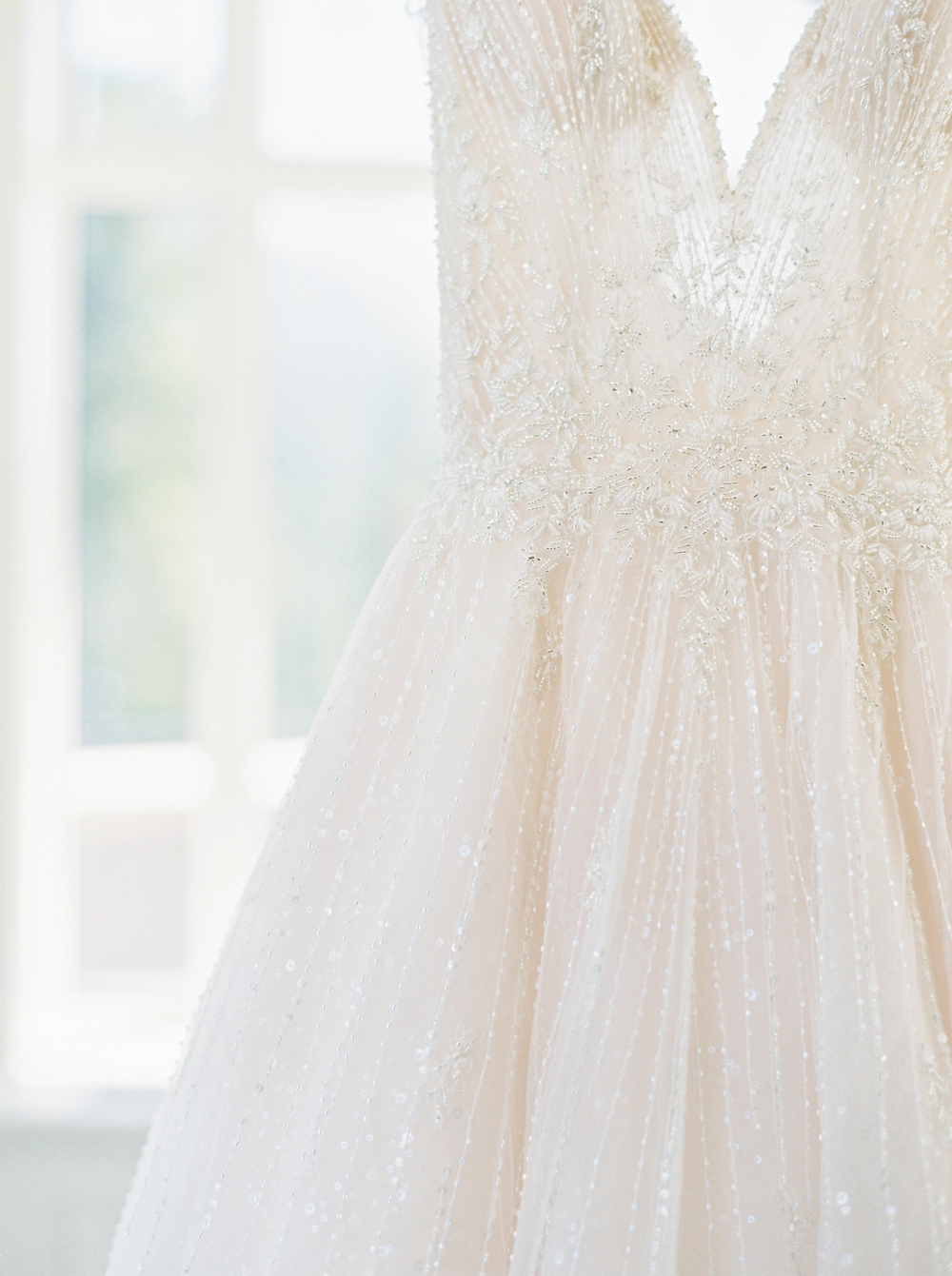 Bride Getting ready wedding details wedding dress with plunging neckline | Banff Wedding Photographers | Justine Milton fine art film photography