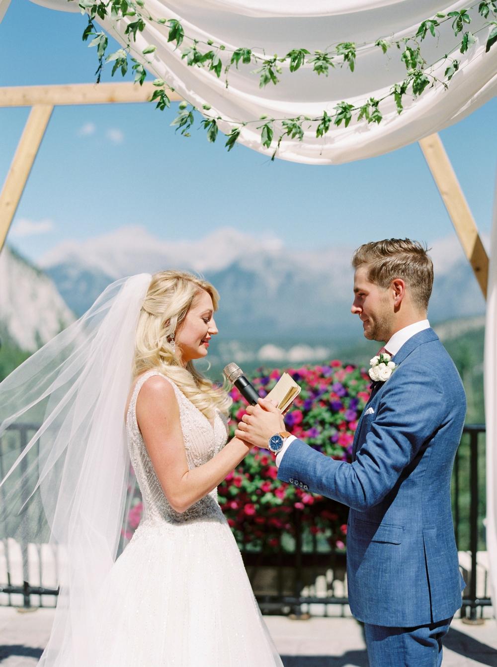 Wedding ceremony floral arch way decor at the Fairmont Banff Springs Hotel | Banff Rocky Mountain Wedding Photographers | Justine Milton fine art film photography