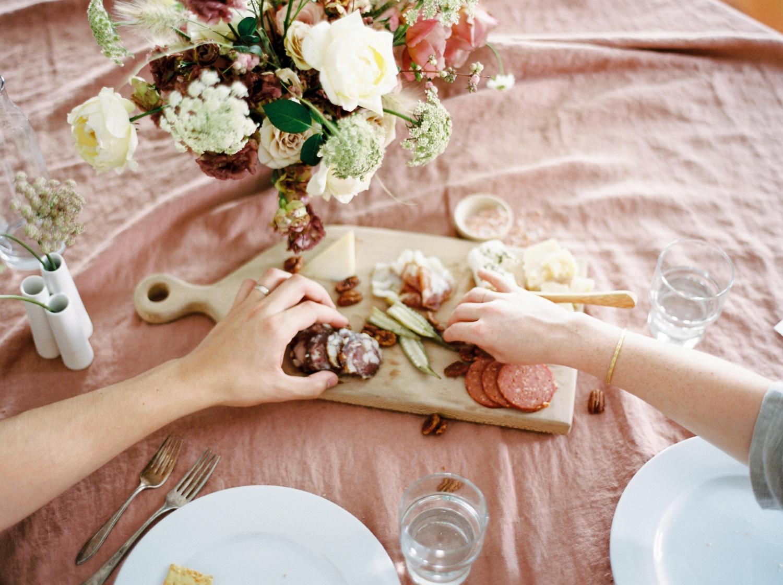Charleston wedding photographer | anniversary dinner | fine art film photography | Calgary Wedding Photographers | Calgary couples photographer | Justine Milton Photography | flowers | table setting