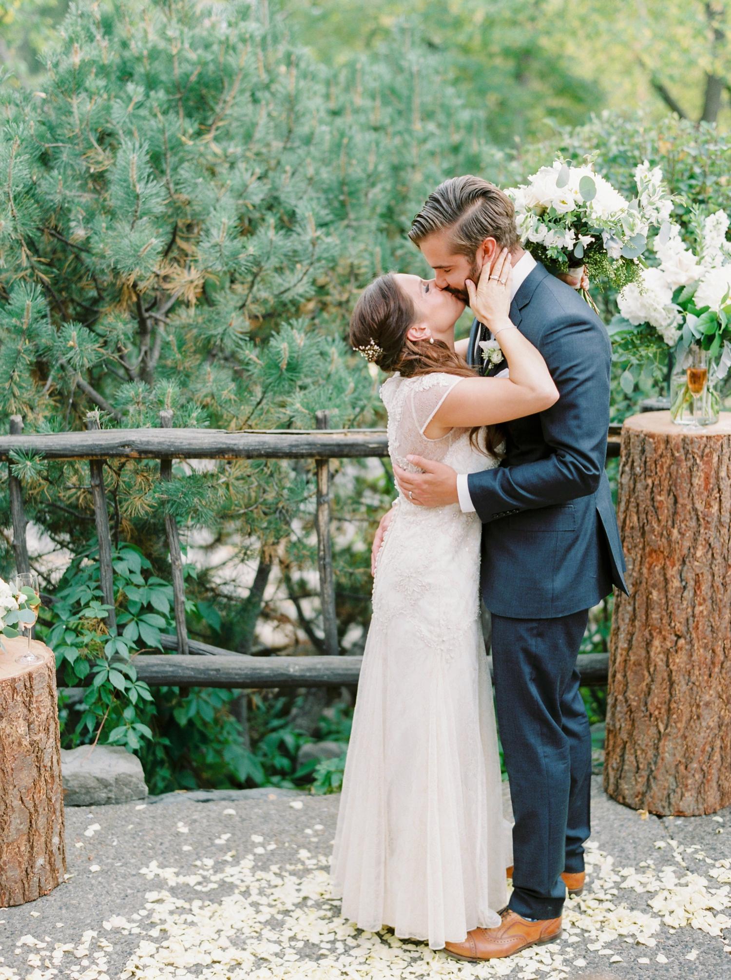 Calgary wedding photographers | fine art film | Justine Milton Photography | wedding inspiration | wedding chairs | wedding flowers | wedding ceremony | bride and groom | kiss the bride