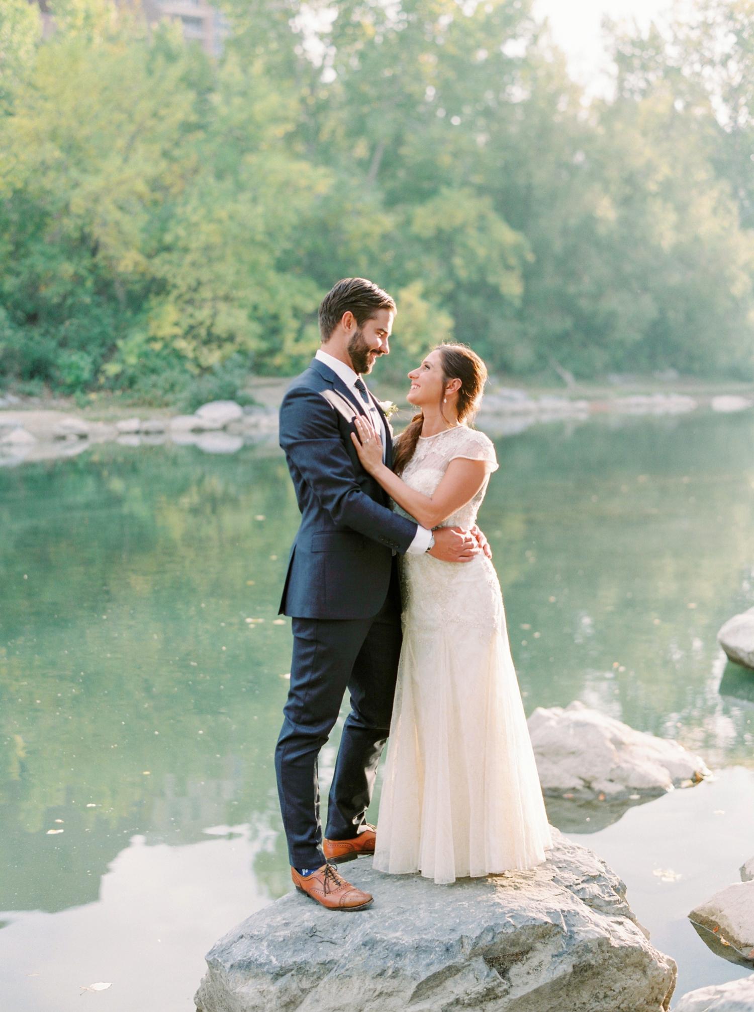 Calgary wedding photographers | fine art film | Justine Milton Photography | wedding inspiration | wedding dress | bride and groom portraits | river