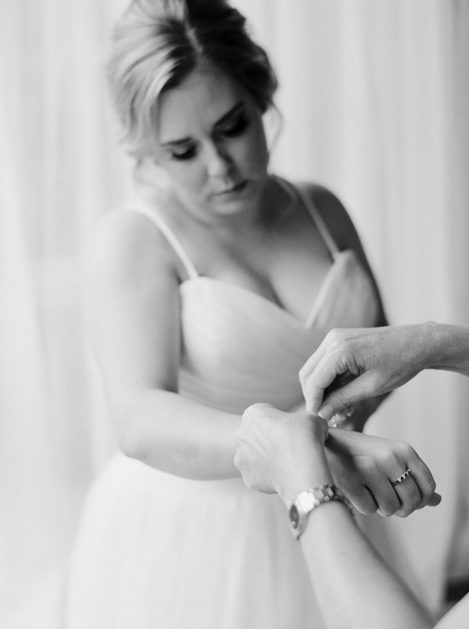 Calgary wedding photographers | banff wedding photographers | fine art film | Justine Milton Photography | bride getting ready | elopement photographers | wedding dress