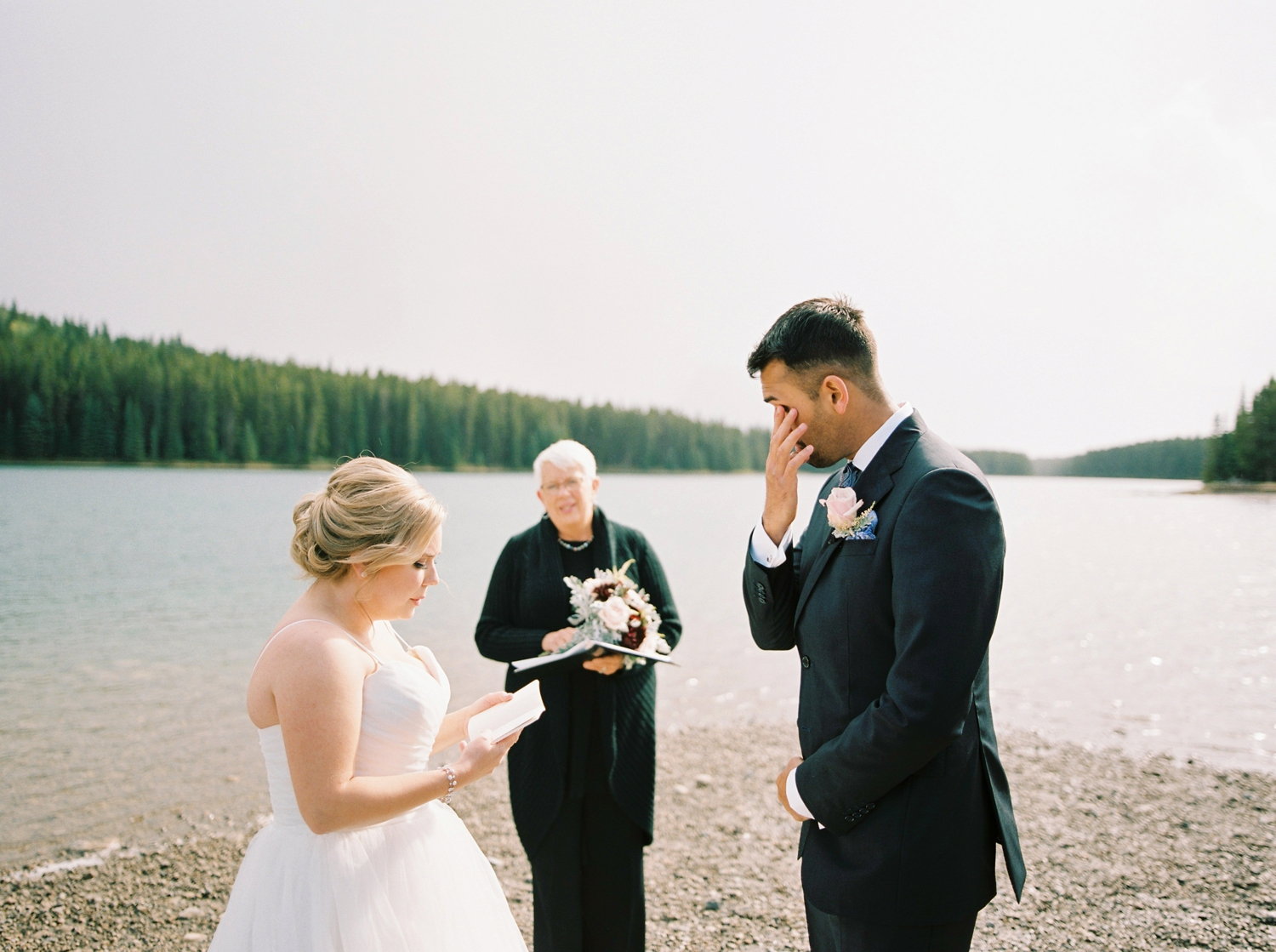 Calgary wedding photographers | banff wedding photographers | fine art film | Justine Milton Photography | wedding vows | elopement photographers | bride and groom ceremony