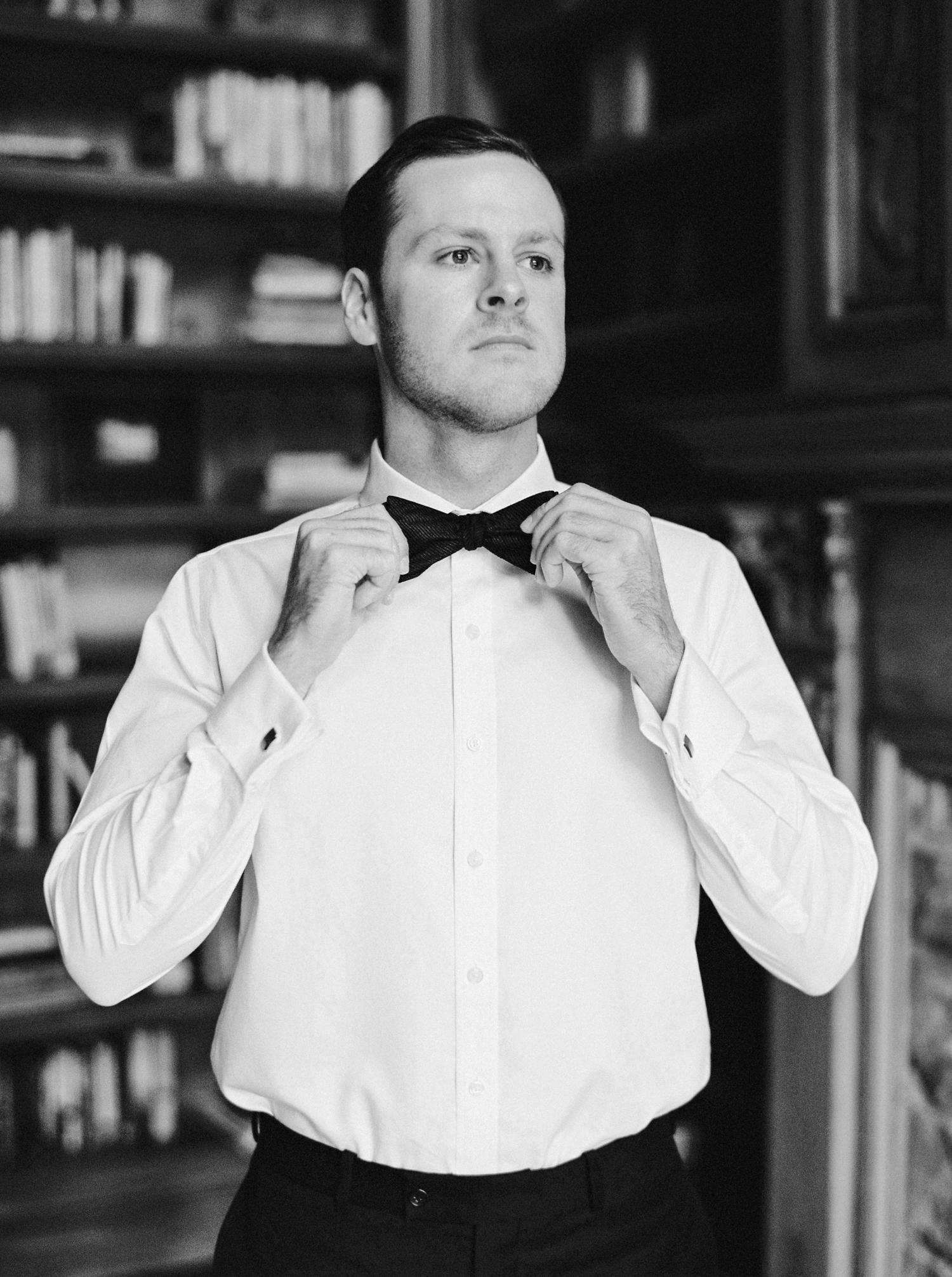 Calgary wedding photographers | georgia wedding photographers | fine art film | Justine Milton Photography | wedding details | georgia wedding | groom getting ready | bowtie