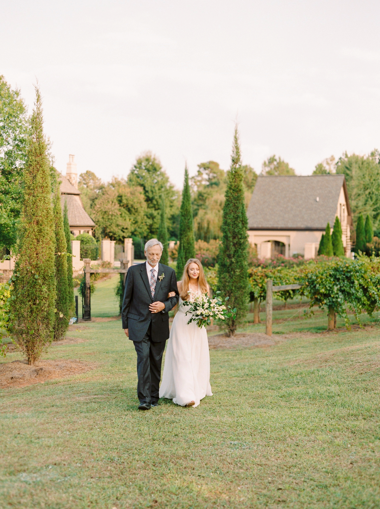 Calgary wedding photographers | georgia wedding photographers | fine art film | Justine Milton Photography | georgia wedding | bride and groom portraits | walking down the aisle | father and bride
