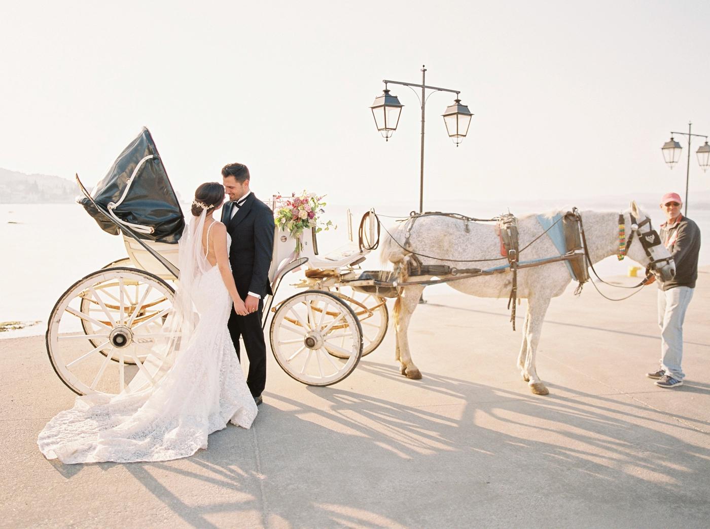 Spetses greece destination wedding photographer | Poseidonion Grand Hotel Wedding | Justine Milton fine art film photography | black and colorful glamorous wedding inspiration horse drawn carriage