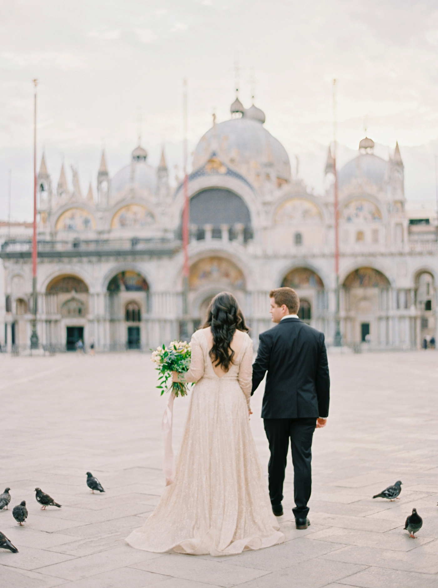 Venice italy wedding photographers | long sleeve wedding dress | italy vow renewal | justine milton fine art film photographer | bride and groom portraits San Marco Square
