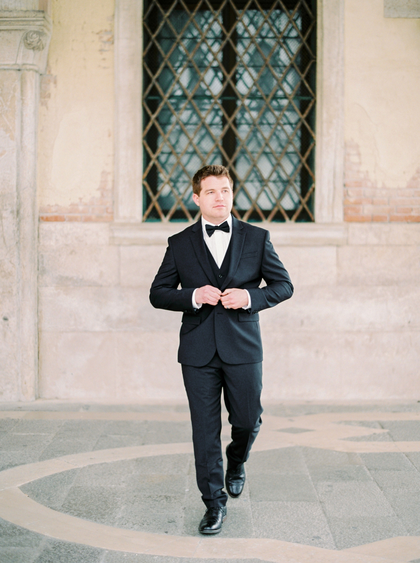 Venice italy wedding photographers | long sleeve wedding dress | italy vow renewal | justine milton fine art film photographer | groom portraits
