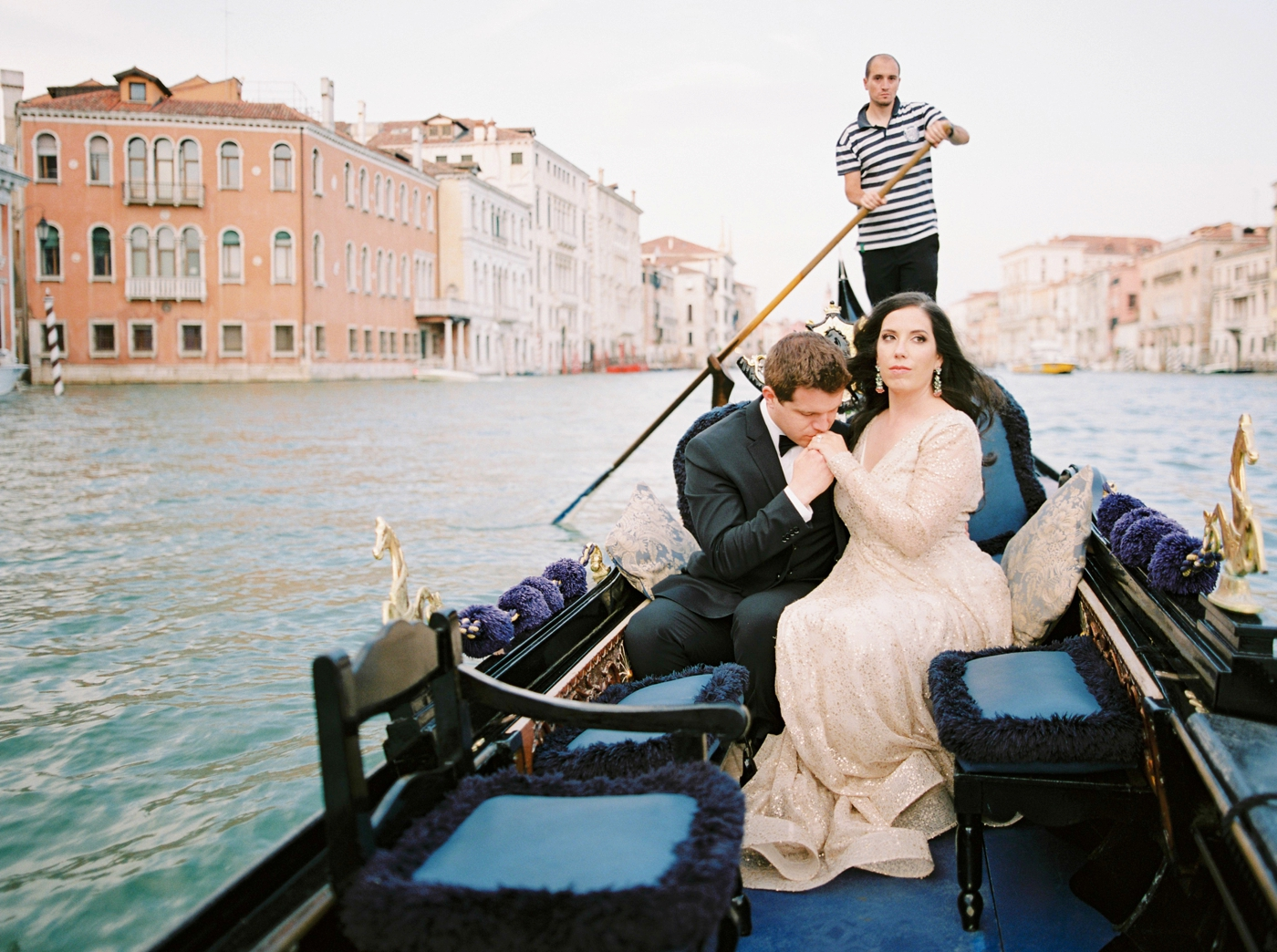 Venice italy wedding photographers | long sleeve wedding dress | italy vow renewal | justine milton fine art film photographer | bride and groom portraits in a gondola