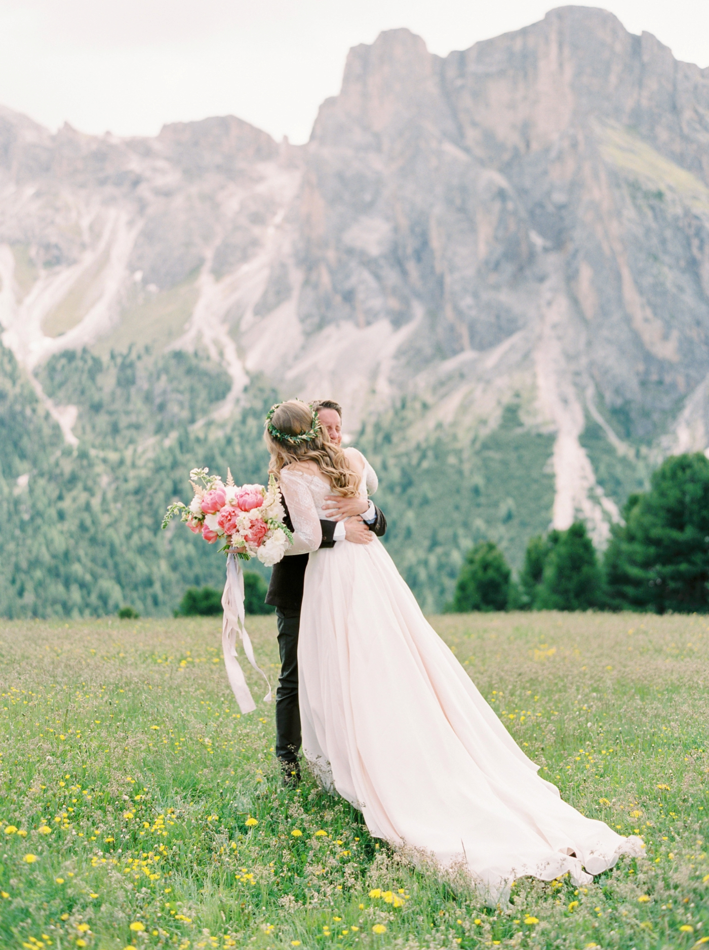 Italy wedding photographers | Dolomites mountain top wedding | pink and white peony bouquet | long sleeve flowing wedding dress | Bride and groom portrait first look | justine milton fine art film photographers
