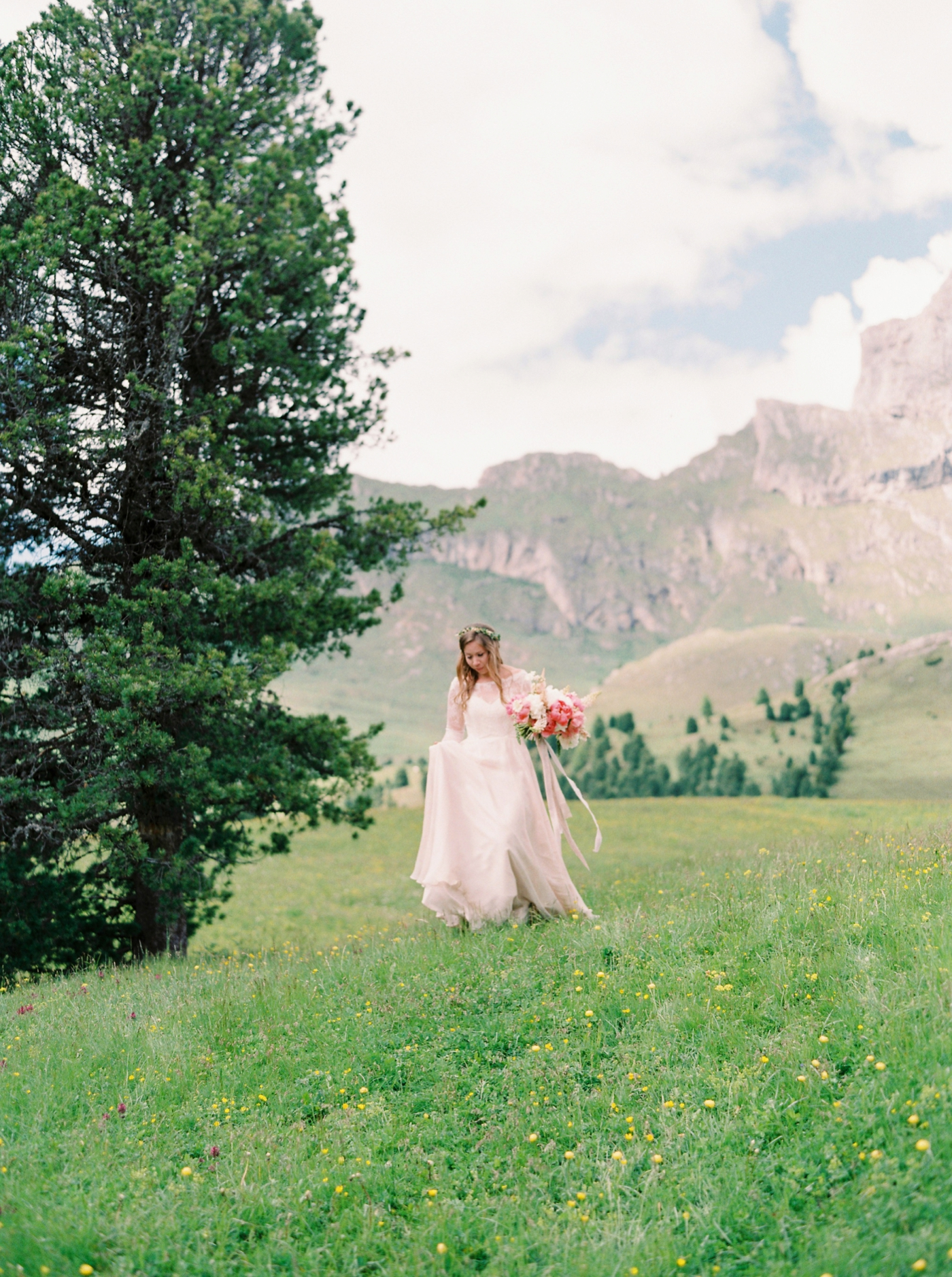 Italy wedding photographers | Dolomites mountain top wedding | pink and white peony bouquet | long sleeve flowing wedding dress | outdoor wedding ceremony ski chalet wedding floral arch | justine milton fine art film photographers
