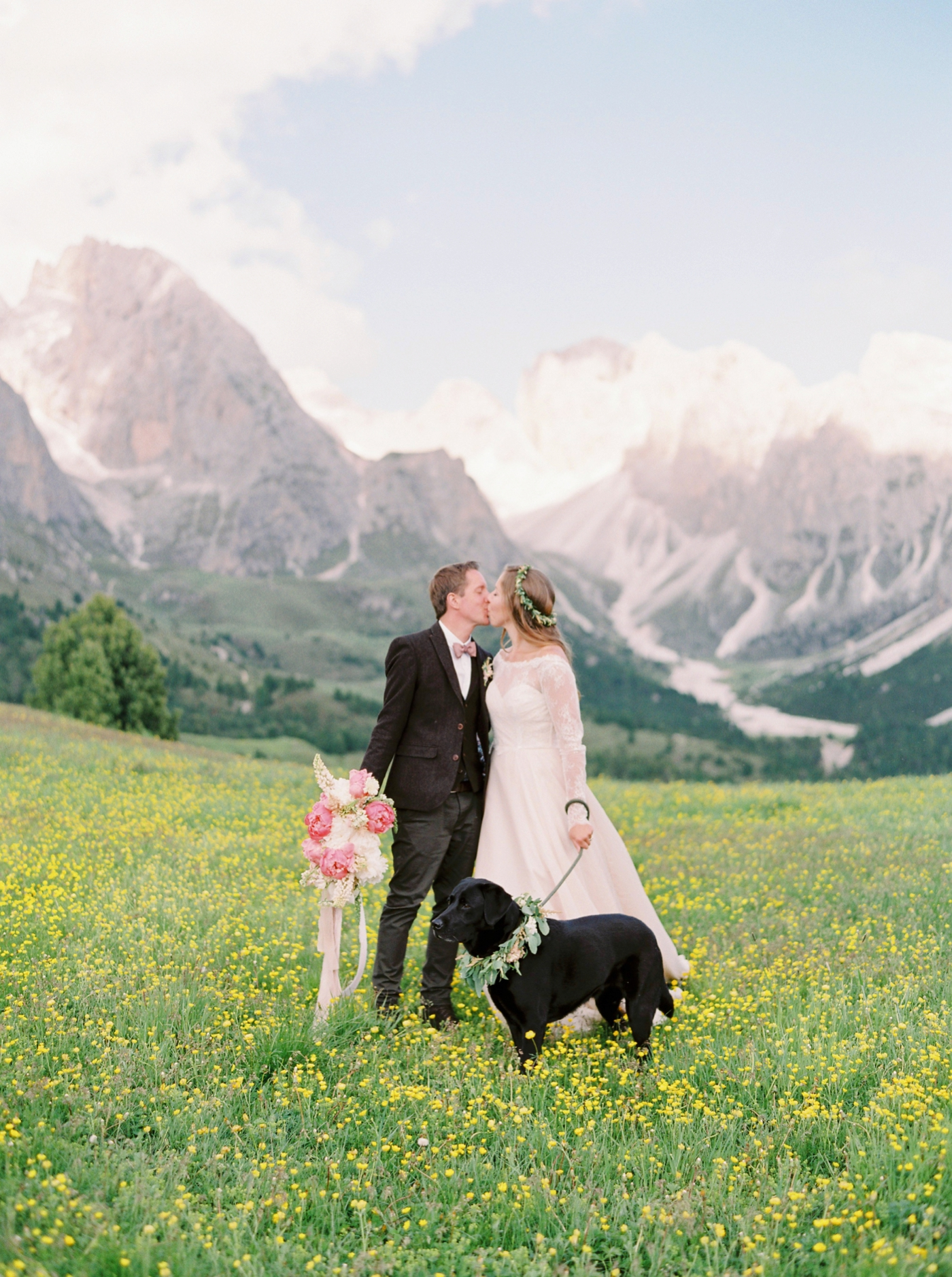 Italy wedding photographers | Dolomites mountain top wedding | pink and white peony bouquet | long sleeve flowing wedding dress | Bride and groom portrait | justine milton fine art film photographers